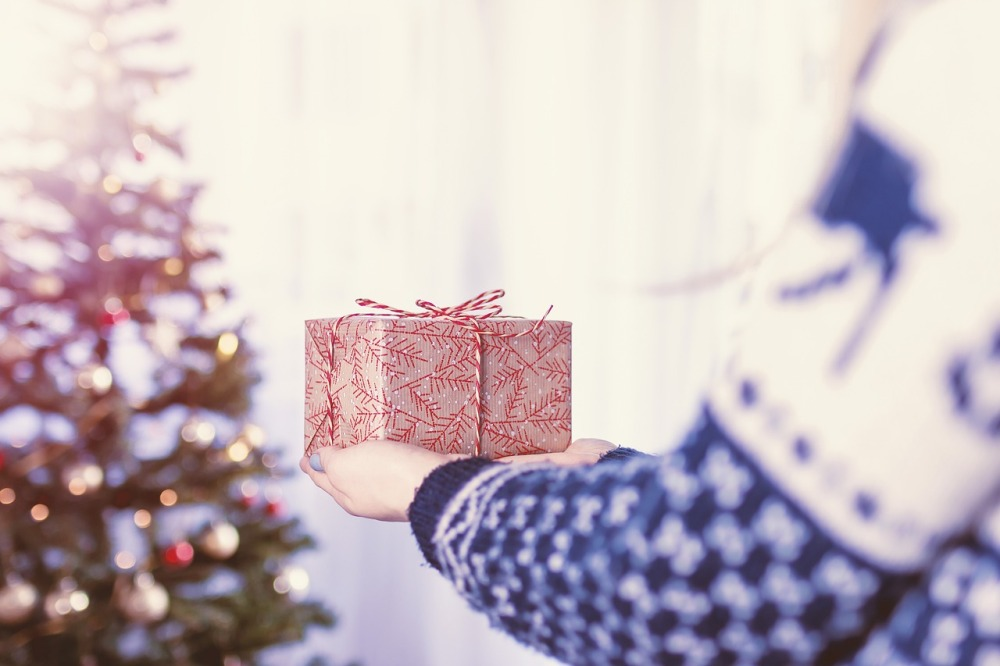 person carrying a Christmas gift